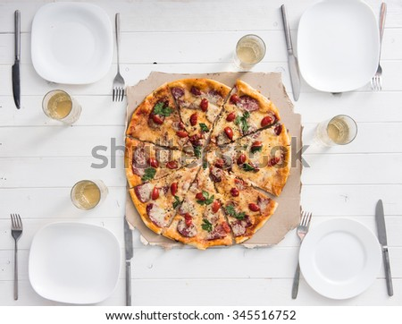 table with pizza set for four persons top view - stock photo