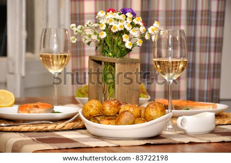 table with potatoes, fish and wine