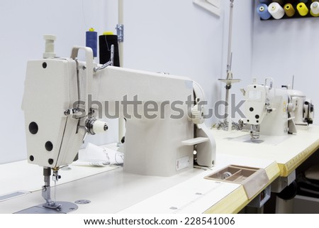 Table with professional sewing machine - stock photo