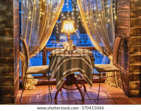 Table with two chairs in cafe - stock photo