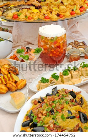 Table with variety of colorful food - stock photo