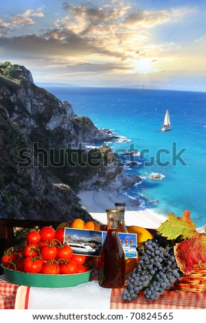 Table with wine and fruit against alone yacht - stock photo