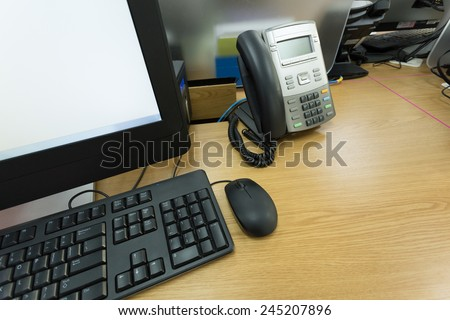 table work in office with telephone and computer pc - stock photo