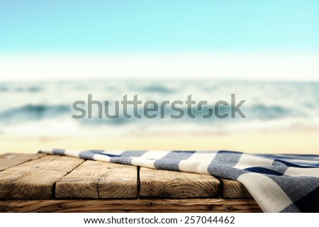 tablecloth and table of wood and sea  - stock photo