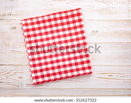 Tablecloth napkin on white wooden table for dinner, menu in restaurant Top view horizontally. Flat mock up for design.Table place setting.