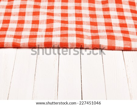 Tablecloth red and white checkered wavy on board  - stock photo