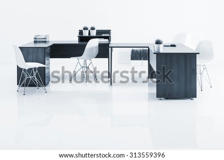 tables and armchairs with reflection on white background - stock photo