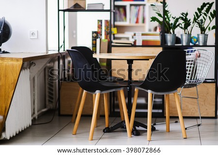 Tables and chairs at intdoors cafe. Meeting place in cafe, interior of restaurant. - stock photo