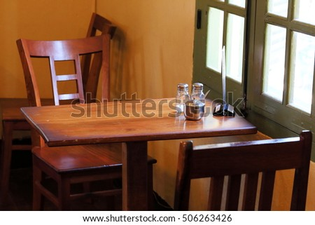 tables and chairs at  restaurant
