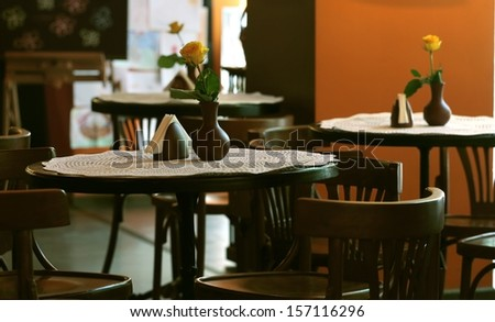 tables and chairs in a cafe  - stock photo