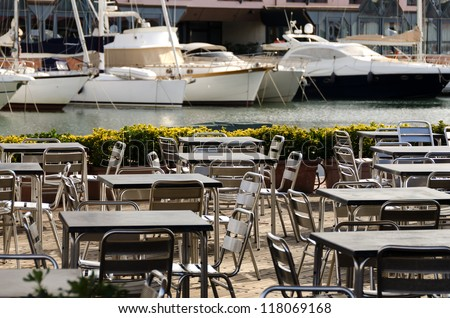 tables and chairs in a seaside restaurant in Genoa
