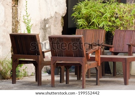 Tables and chairs in front of the store.