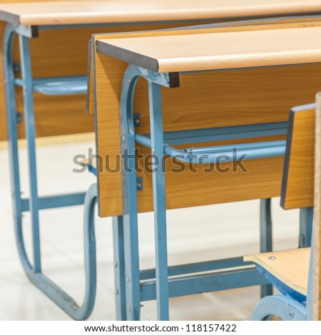tables and chairs in the classroom - stock photo