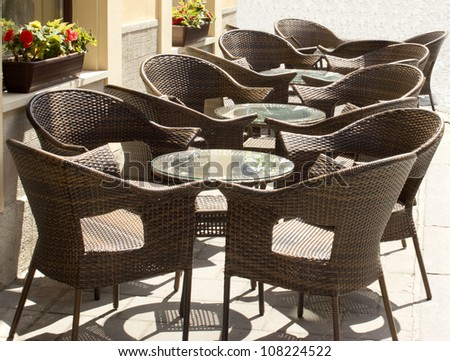 tables and chairs in the restaurant - stock photo