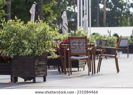 Tables and chairs of outdoor cafe - stock photo