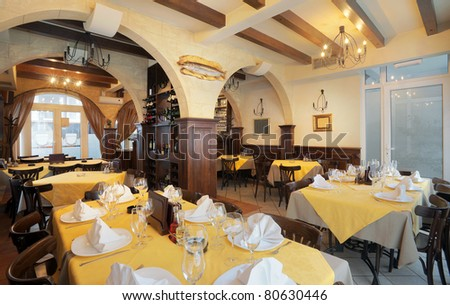Tables, chairs and lighting equipment of a restaurant. - stock photo