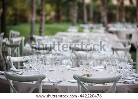 Tables decor in the restaurant on wedding day. Paster decorations, outdoor - stock photo