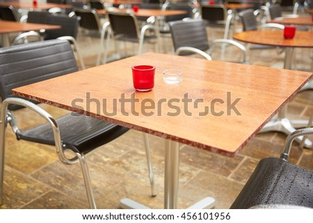 tables of street cafes in Italy - stock photo