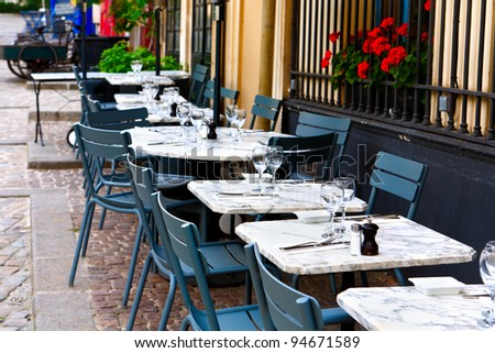 tables on the street, french restaurant - Paris, France - stock photo