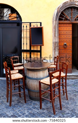 tables on the street, italian restaurant - Rome, Italy - stock photo