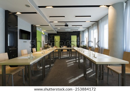Tables prepared for conference in modern conference hall - stock photo