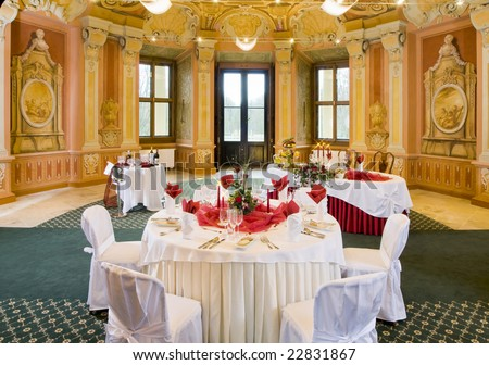 Tables set for a festive dinner - stock photo