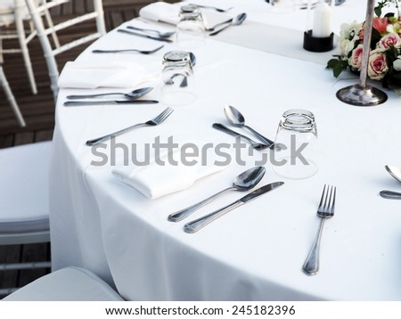 Tables set for dinner wedding day - stock photo