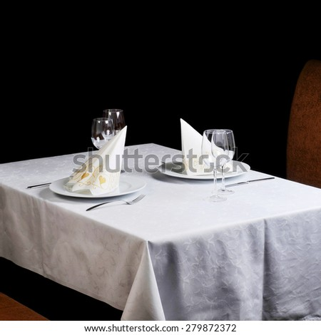 Tables set for  meal in  modern  restaurant - stock photo