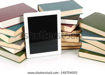Tablet and books isolated on white - stock photo