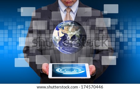 Tablet and business man : Elements of this image furnished by NASA - stock photo