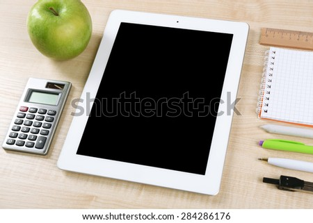 Tablet and school supplies on wooden table, closeup - stock photo