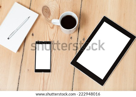 tablet and smartphone and book on wooden floor - stock photo