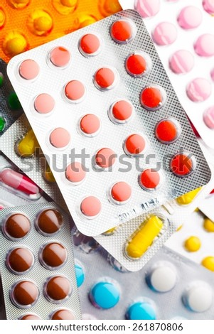 Tablet. Colorful oral contraceptive pill. - stock photo