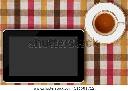 tablet computer and coffee cup - stock photo