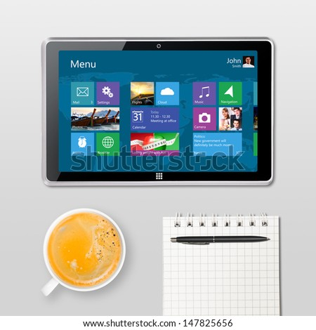 tablet computer and cup of coffee on table, view from above