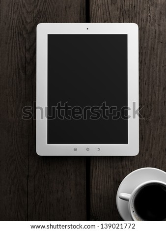 tablet computer and cup of tea on wooden table - stock photo