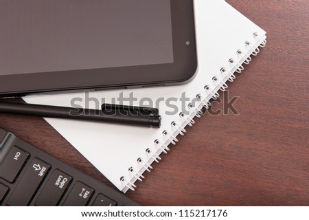 Tablet computer and laptop, pen and paper notebook - stock photo