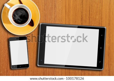 Tablet computer and Smart Phone on Wood Table with hot coffee - stock photo