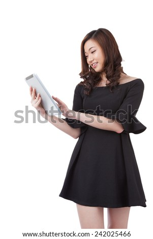 Tablet computer business woman using digital tablet computer PC happy isolated on white background. Beautiful mixed race Asian with finger on touch screen display. - stock photo