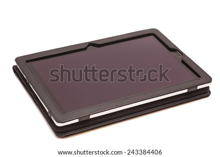 Tablet computer in cover isolated on white - stock photo