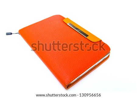 Tablet computer in orange case - stock photo