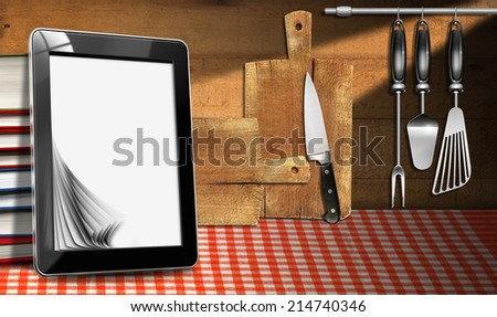 Tablet Computer in the Kitchen / Tablet computer with blank pages and stack of books in a kitchen, on wooden wall with kitchen utensils. Template for recipes or food menu - stock photo