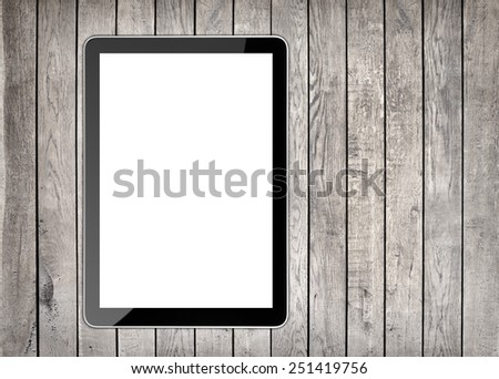 tablet computer isolated like ipades on wood  background - stock photo