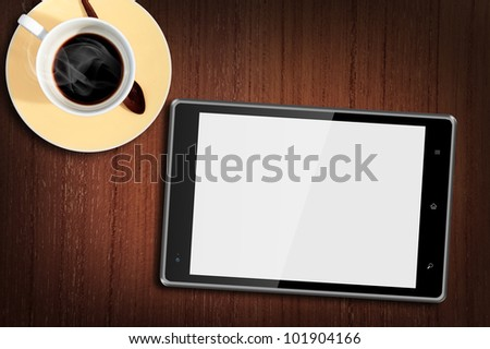 Tablet computer on Wood Table with a cup of coffee
