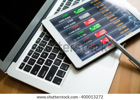 Tablet computer showing stock marketing data - stock photo