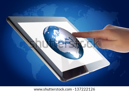 Tablet Computer with a hand pressing world globe icon