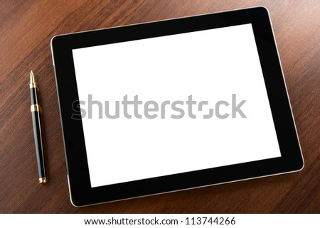 Tablet computer with blank screen on a businessman workplace - stock photo