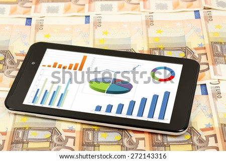 tablet computer with graphs on banknotes, making money concept - stock photo