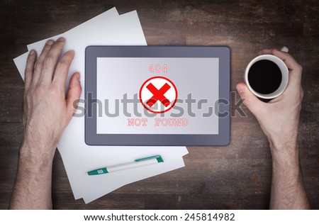 Tablet displaying an error, 404, not found - stock photo
