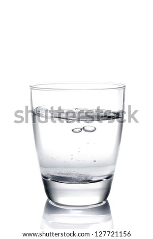 tablet dropped into the water on white background - stock photo